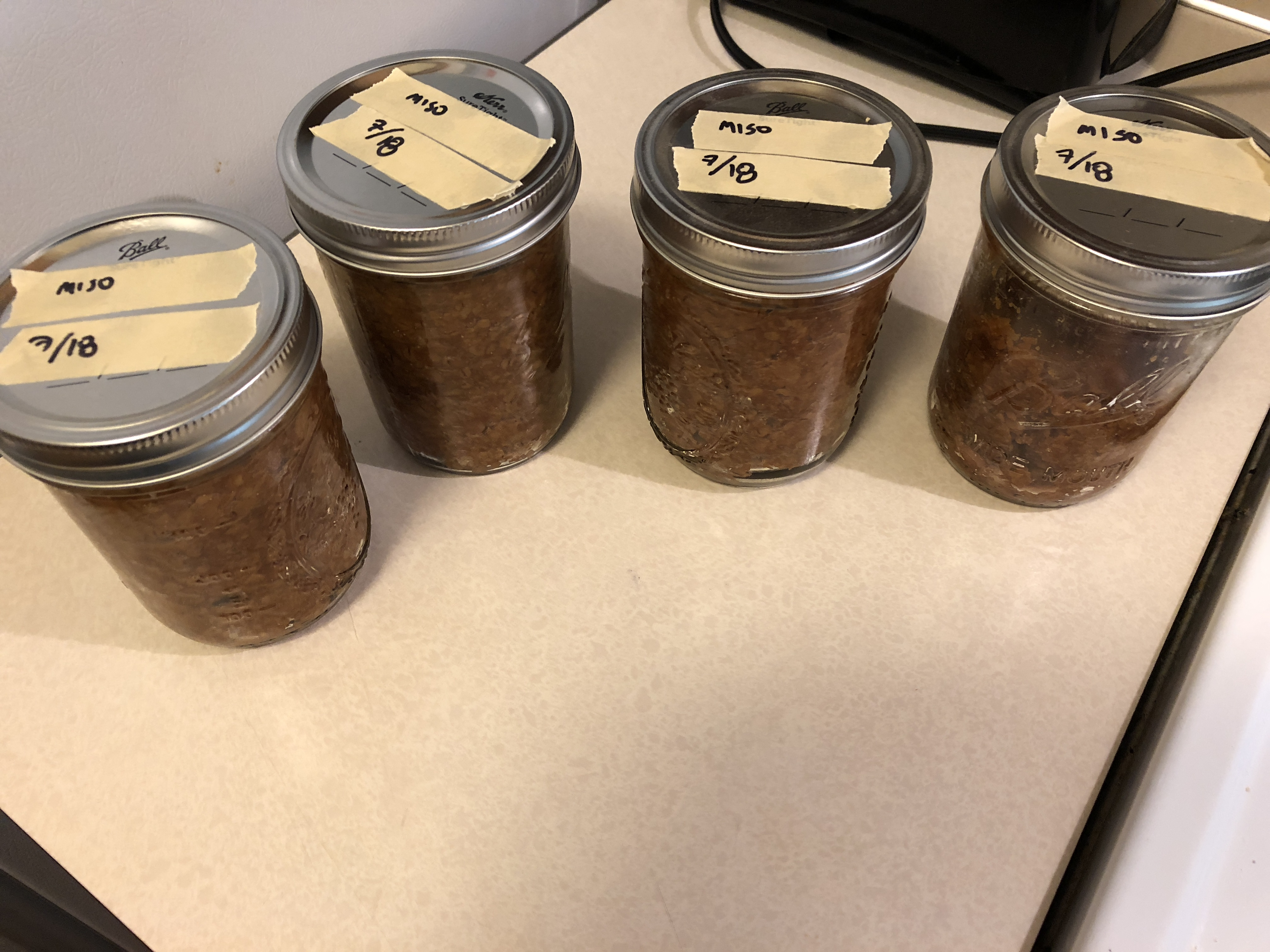 Miso packed into storage jars.